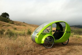 Electric-assist tricycle with solar panel on roof. (OrganicTransit.com)